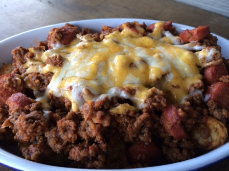 Chili Cheese Dog Tater Tot Bake, shown here made in a small casserole dish for two