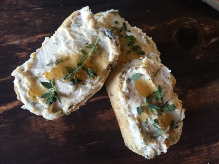Honey drizzled goat cheese crostini